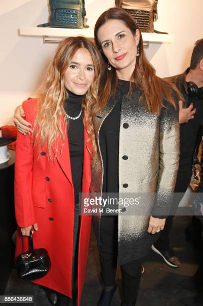Miroslava Duma and Livia Firth attend the opening of the BOTTLETOP flagship store on Regent Street on December 5 2017 in London England