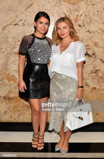 Miroslava Duma and Nasiba Adilova attend the Gucci beauty launch event hosted by Frida Giannini on June 4 2014 in New York City