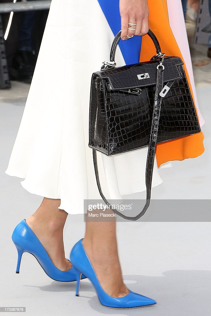 Miroslava Duma (handbag and shoe detail) arrives to attend the Christian Dior show as part of Paris Fashion Week Haute Couture Fall/Winter 2013-2014 at on July 1, 2013 in Paris, France.