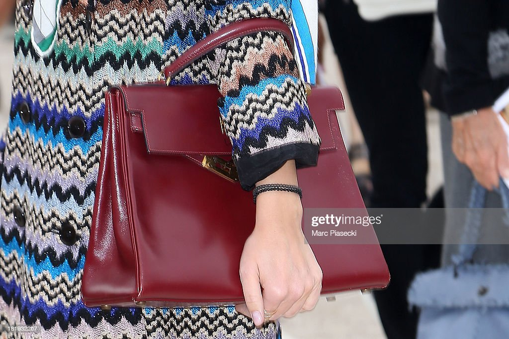 <a gi-track='captionPersonalityLinkClicked' href=/galleries/search?phrase=Miroslava+Duma&family=editorial&specificpeople=7039024 ng-click='$event.stopPropagation()'>Miroslava Duma</a> (handbag detail) arrives to attend the Nina Ricci show as part of the Paris Fashion Week Womenswear Spring/Summer 2014 on September 26, 2013 in Paris, France.