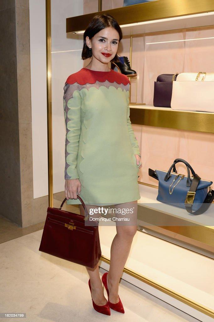 Miroslava Duma attends 'Chloe Attitudes' book launch celebration cocktail as part of the Paris Fashion Week Womenswear Spring/Summer 2014 on...