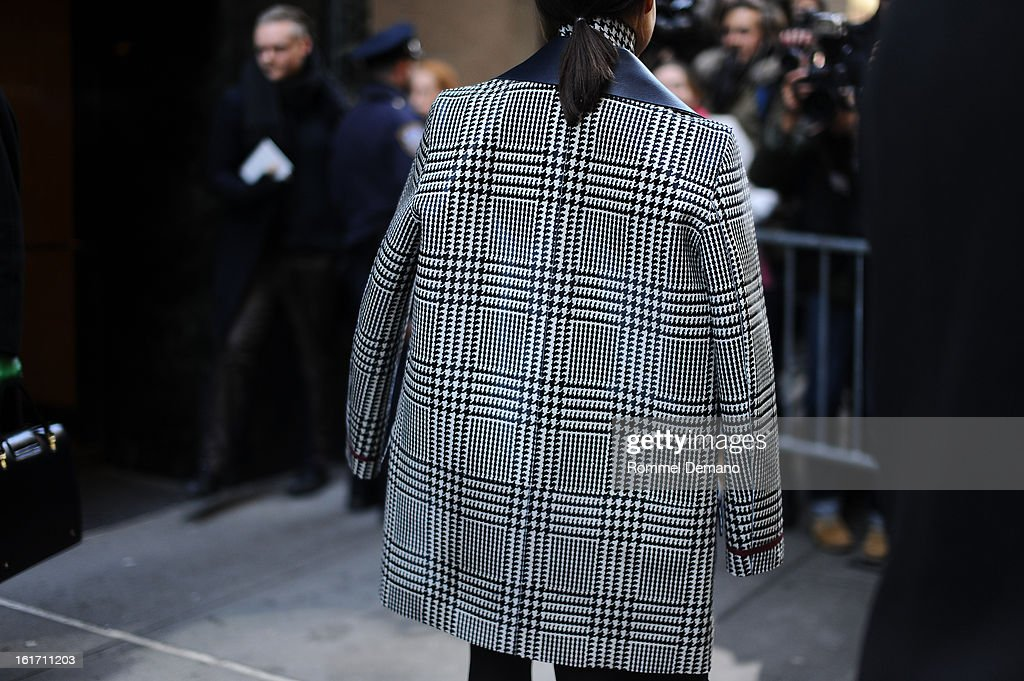 Miroslava Duma attends the Calvin Klein show wearing a Tommy Hilfiger jacket on February 14, 2013 in New York City.