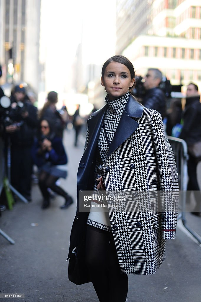 Miroslava Duma attends the Calvin Klein show wearing a Tommy Hillfiger jacket on February 14, 2013 in New York City.