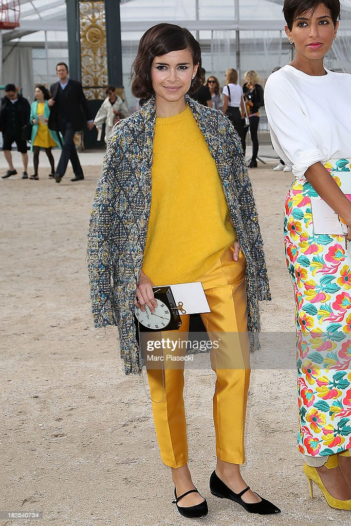 <a gi-track='captionPersonalityLinkClicked' href=/galleries/search?phrase=Miroslava+Duma&family=editorial&specificpeople=7039024 ng-click='$event.stopPropagation()'>Miroslava Duma</a> (L) attends the Elie Saab show as part of the Paris Fashion Week Womenswear Spring/Summer 2014 on September 30, 2013 in Paris, France.