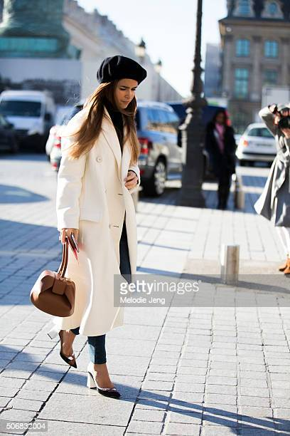 Miroslava Duma attends the Schiaparelli show at Place Vendome in a white coat black beret on January 25 2016 in Paris France