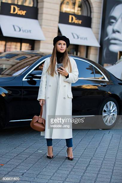 Miroslava Duma attends the Schiaparelli show in a white coat and black beret on January 25 2016 in Paris France