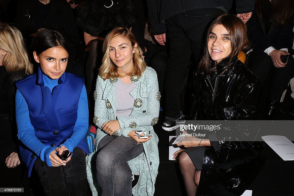 <a gi-track='captionPersonalityLinkClicked' href=/galleries/search?phrase=Miroslava+Duma&family=editorial&specificpeople=7039024 ng-click='$event.stopPropagation()'>Miroslava Duma</a>, guest and <a gi-track='captionPersonalityLinkClicked' href=/galleries/search?phrase=Carine+Roitfeld&family=editorial&specificpeople=240177 ng-click='$event.stopPropagation()'>Carine Roitfeld</a> attend the Nina Ricci show as part of the Paris Fashion Week Womenswear Fall/Winter 2014-2015 on February 27, 2014 in Paris, France.