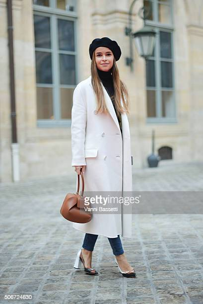 Miroslava Duma poses wearing a Preen coat before the Schiaparelli show at Place Vendome during Haute Couture on January 25 2016 in Paris France