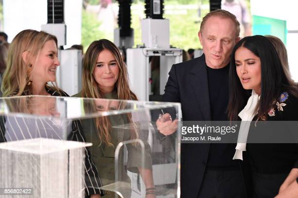 Miroslava Duma presents projects to FrancoisHenri Pinault and Salma Hayek during the Fashion Tech Lab launch event as part of Paris Fashion Week...