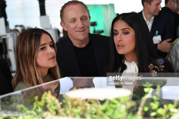 Miroslava Duma presents projects to FranoisHenri Pinault and Salma Hayek during the Fashion Tech Lab launch event as part of Paris Fashion Week...