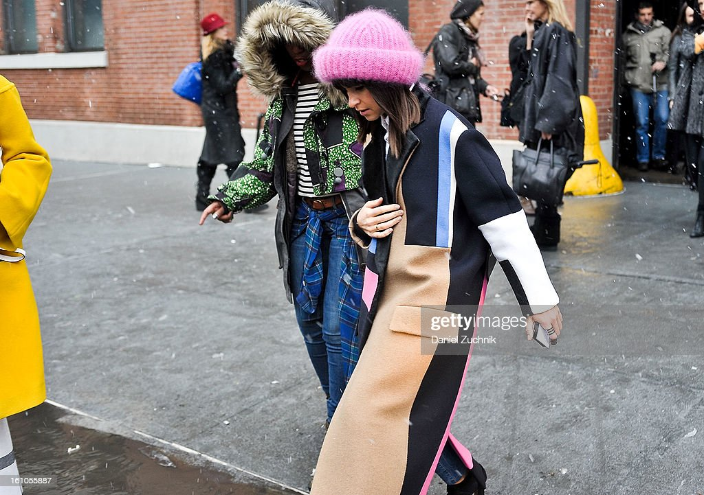 <a gi-track='captionPersonalityLinkClicked' href=/galleries/search?phrase=Miroslava+Duma&family=editorial&specificpeople=7039024 ng-click='$event.stopPropagation()'>Miroslava Duma</a>(R) seen outside the Yigal Azrouel show on February 7, 2013 in New York City.