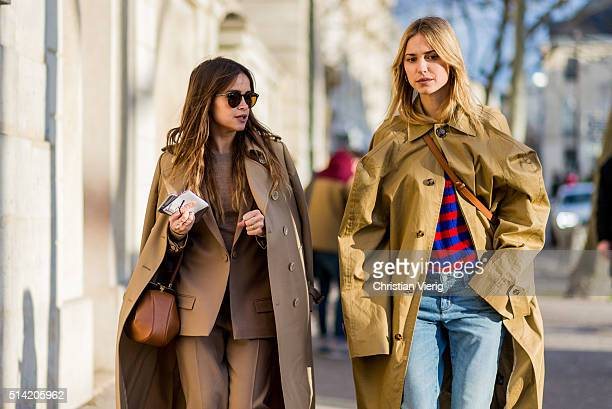 Miroslava Duma wearing a beige coat and suit and Loewe bag and Pernille Teisbaek is wearing a Chloe bag a beige Vetements coat denim jeans outside...