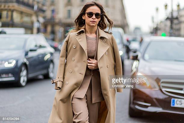 Miroslava Duma wearing a beige suit and trench coat outside Stella McCartney during the Paris Fashion Week Womenswear Fall/Winter 2016/2017 on March...