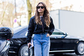 Miroslava Duma wearing a black bomber jacket and blue Vetements denim jeans outside Rochas during the Paris Fashion Week Womenswear Fall/Winter...