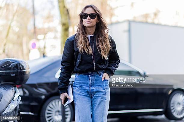 Miroslava Duma wearing a black bomber jacket and blue Vetements denim jeans outside Rochas during the Paris Fashion Week Womenswear Fall/Winter...