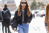 Miroslava Duma wearing a black Burberry backpack and bomber jacket and a blue Vetements denim jeans outside Dries van Noten during the Paris Fashion...