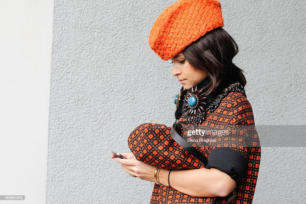 Miroslava Duma wearing a Marni total look and Stak.ori hat, attends the Milan Fashion Week Womenswear Fall/Winter 2013/14 on February 25, 2013 in Milan, Italy.