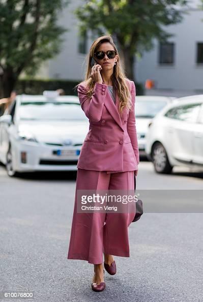 Miroslava Duma wearing a pink suit outside Armani during Milan Fashion Week Spring/Summer 2017 on September 23 2016 in Milan Italy