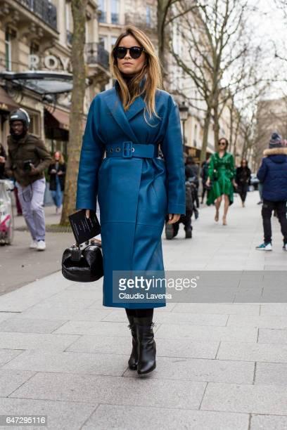 Miroslava Duma wears a blue coat outside the Balmain show during Paris Fashion Week Womenswear Fall/Winter 2017/2018 on March 2 2017 in Paris France