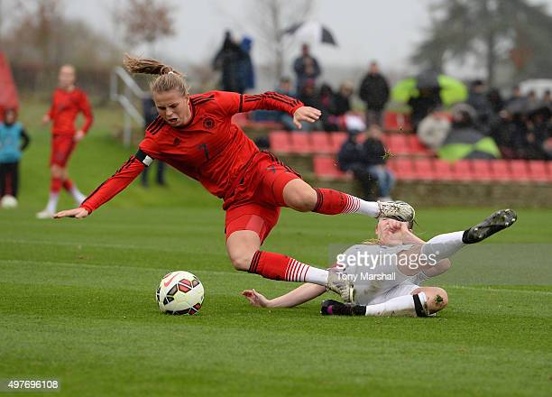 Mirri Taylor of England brings down Klara Buhl of Germany for a penalty during Women's U16s International Friendly match between England U16s Women...