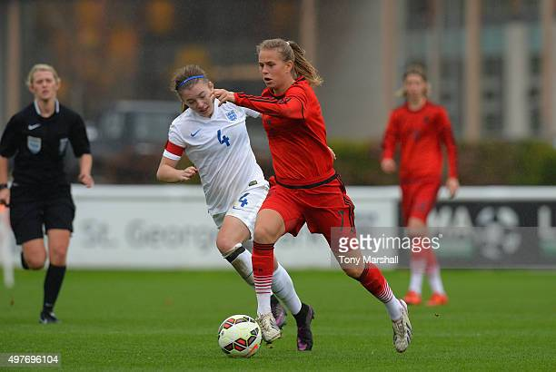 Mirri Taylor of England challenges Klara Buhl of Germany for a penalty during Women's U16s International Friendly match between England U16s Women...