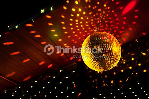 Mirror disco ball with light reflection on the ceiling stock photo mirror disco ball with light reflection on the ceiling stock photo aloadofball Images