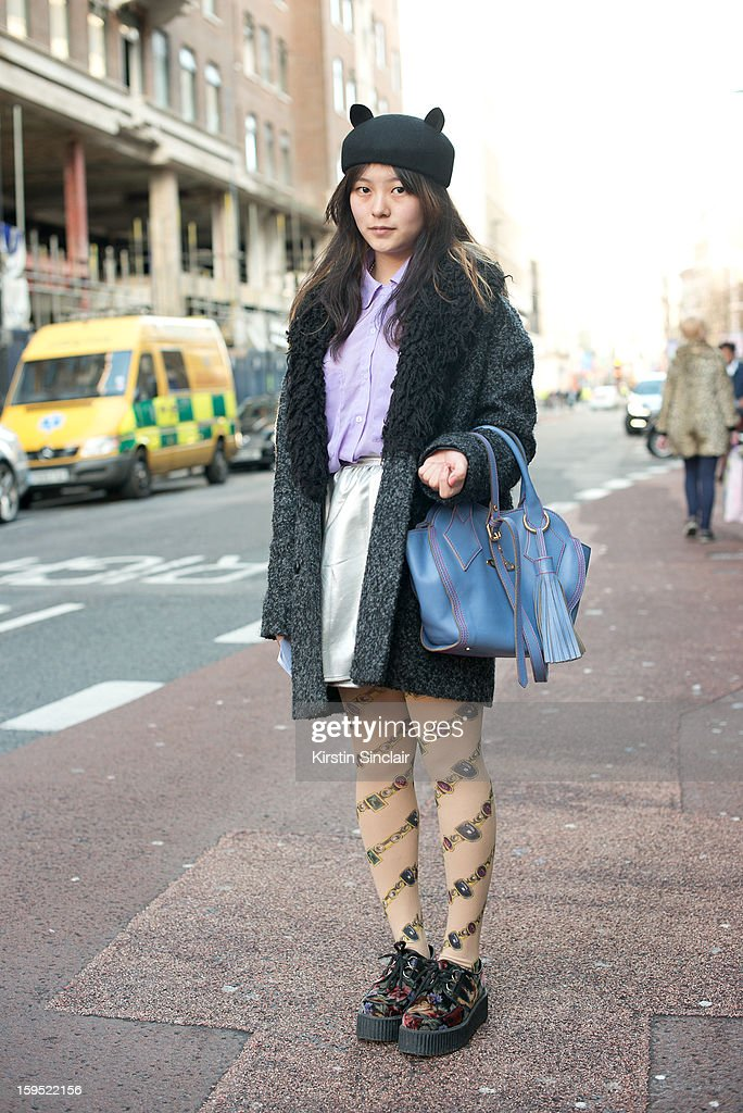 Mirror Meng fashion student wearing a Vivienne Westwood bag, Underground shoes, The little things tights, Urban Outfitters Jacket, American Appareil shirt and skirt and hat from a small London boutique on day 3 of London Mens Fashion Week Autumn/Winter 2013, on January 09, 2013 in London, England.