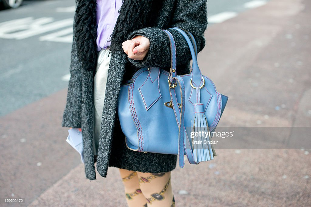 Mirror Meng fashion student wearing a Vivienne Westwood bag,The little things tights, Urban Outfitters Jacket, American Appareil shirt and skirt from a small London boutique on day 3 of London Mens Fashion Week Autumn/Winter 2013, on January 09, 2013 in London, England.