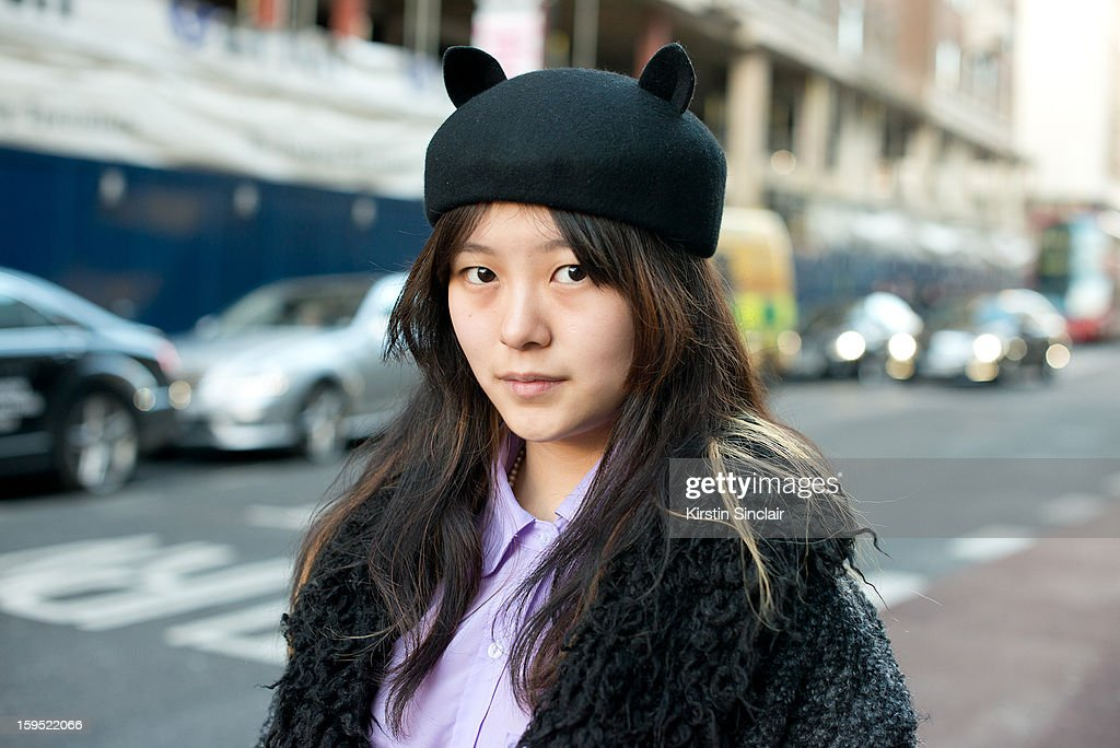 Mirror Meng fashion student wearing an Urban Outfitters Jacket, American Appareil shirt and a hat from a small London boutique on day 3 of London Mens Fashion Week Autumn/Winter 2013, on January 09, 2013 in London, England.