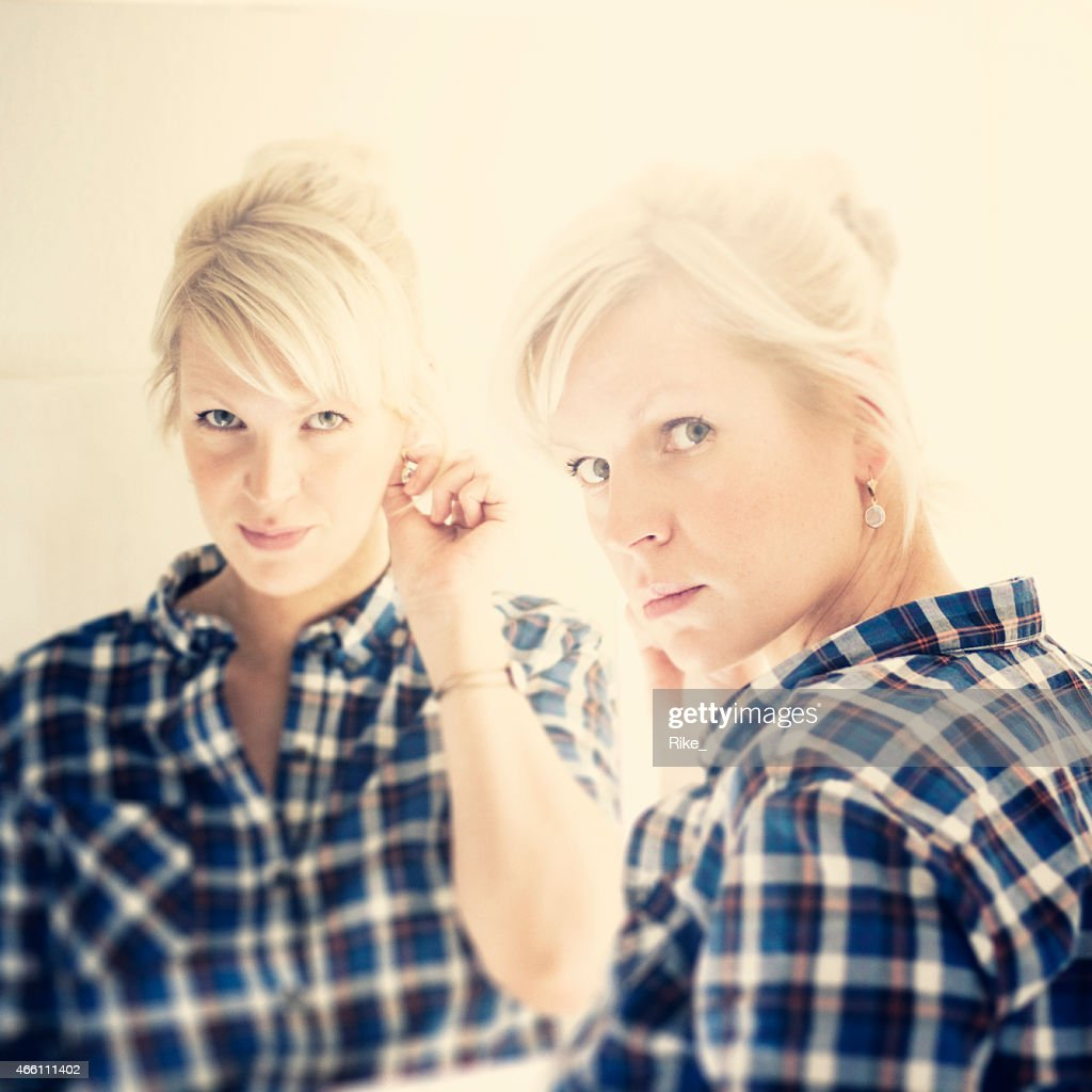 Mirror mirror on the wall......blond woman and her reflection
