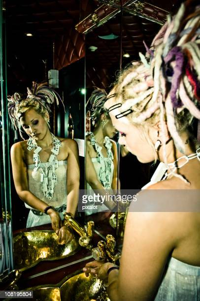 Mirror of Woman with Dreadlocks Washing Hands