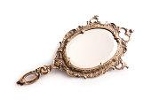 Beautiful vintage isolated hand mirror.