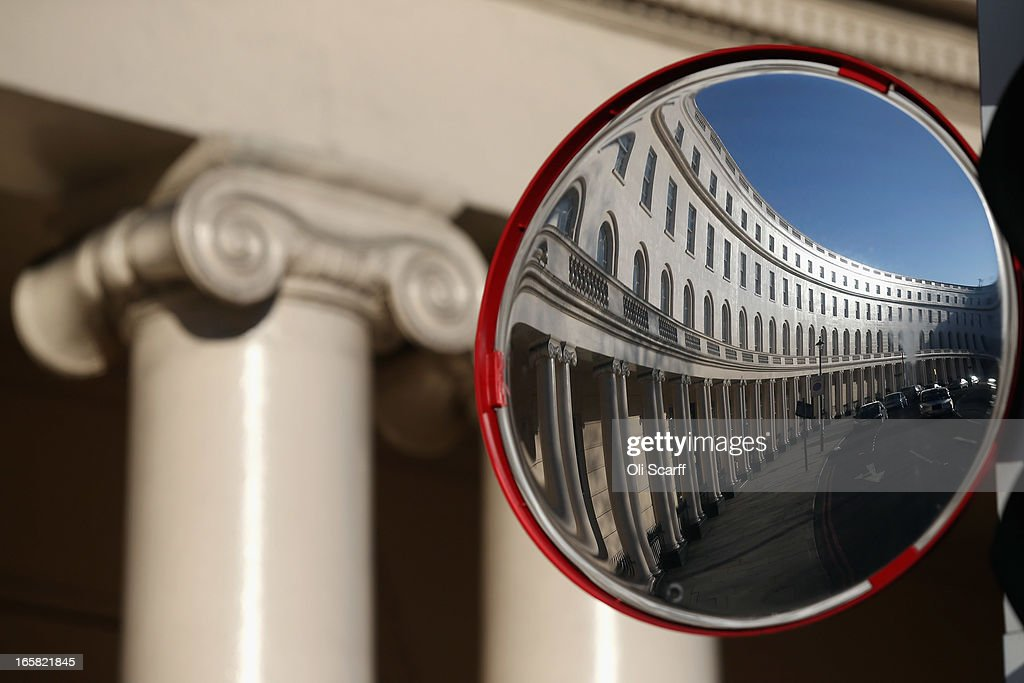 A mirror reflected view of a terrace of residential properties in an affluent area of London adjacent to Regents Park on April 6, 2013 in London, England. Recent research has indicated that average monthly rents in central London have exceeded 5,000 GBP.