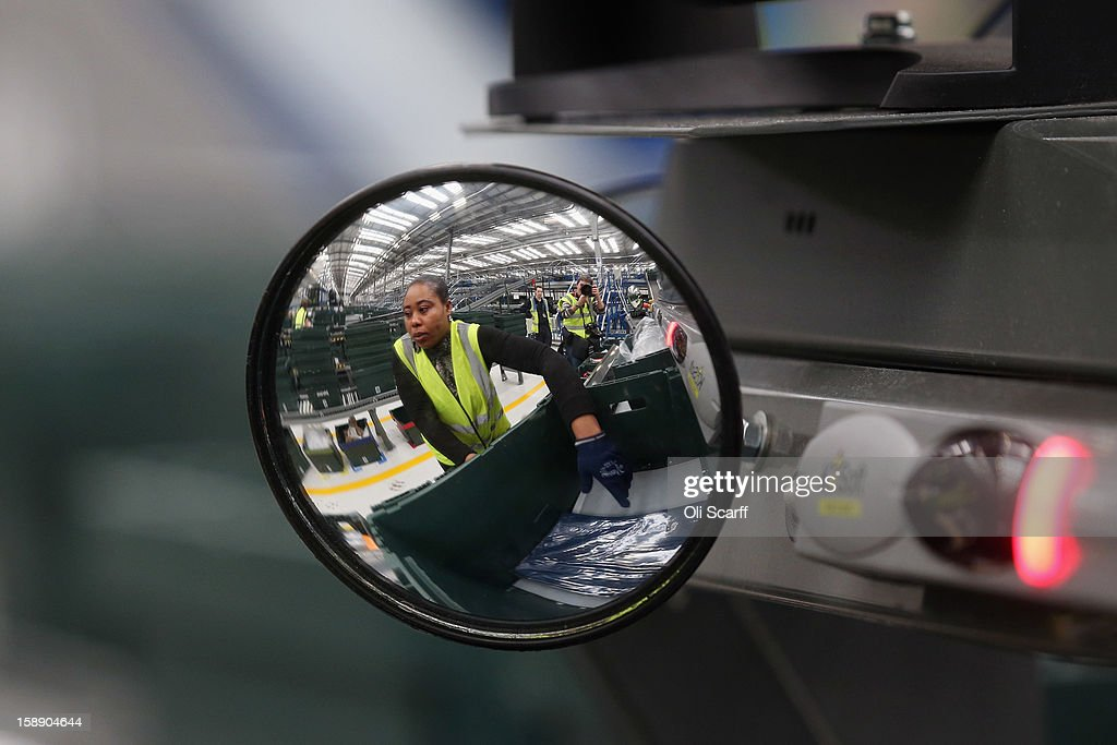 A mirror reflects a worker in the giant semi-automated distribution centre where the company's partners process the online orders for the John Lewis department store on January 3, 2013 in Milton Keynes, England. John Lewis has published their sales report for the five weeks prior December 29, 2012 which showed online sales had increased by 44.3 per cent over the same period in 2011. Purchases from their website Johnlewis.com now account for one quarter of all John Lewis business.