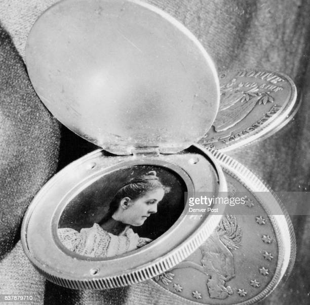 A mirror reflects the 1878 silver dollar owned by ED Dulaney 4425 Eldridge St Jefferson county containing the picture of a mystery woman Credit...