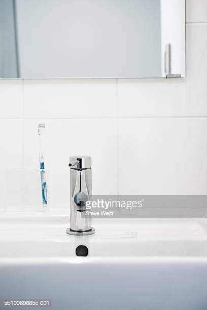 Mirror, toothbrush and tap