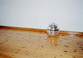 Mirrored disco ball on a hardwood floor