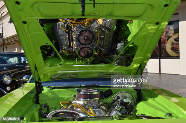Mirrored hood shows off the high powered 1972 Plymouth Baracudda engine on display at the at the Hot August Nights Custom Car Show the largest...