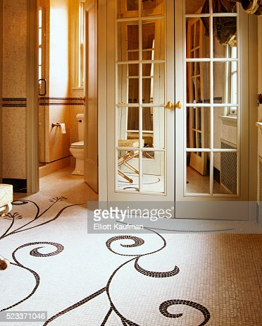 Mirrored French Doors mirrored panels on french doors in bathroom with simple floor