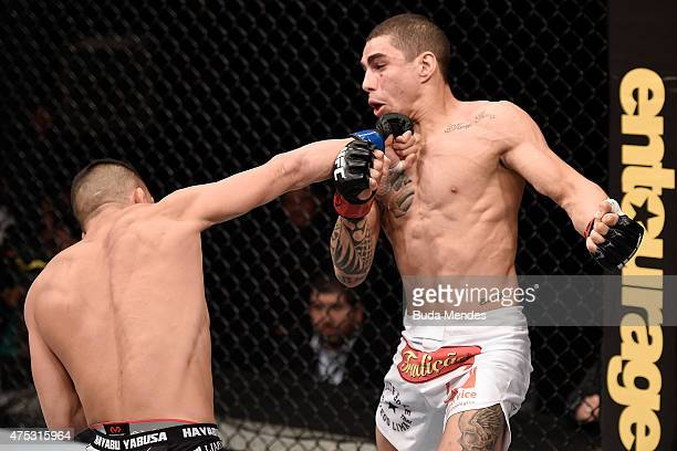 Mirsad Bektic of Bosnia punches Lucas Martins of Brazil in their featherweight UFC bout during the UFC Fight Night Condit v Alves at Arena Goiania on...