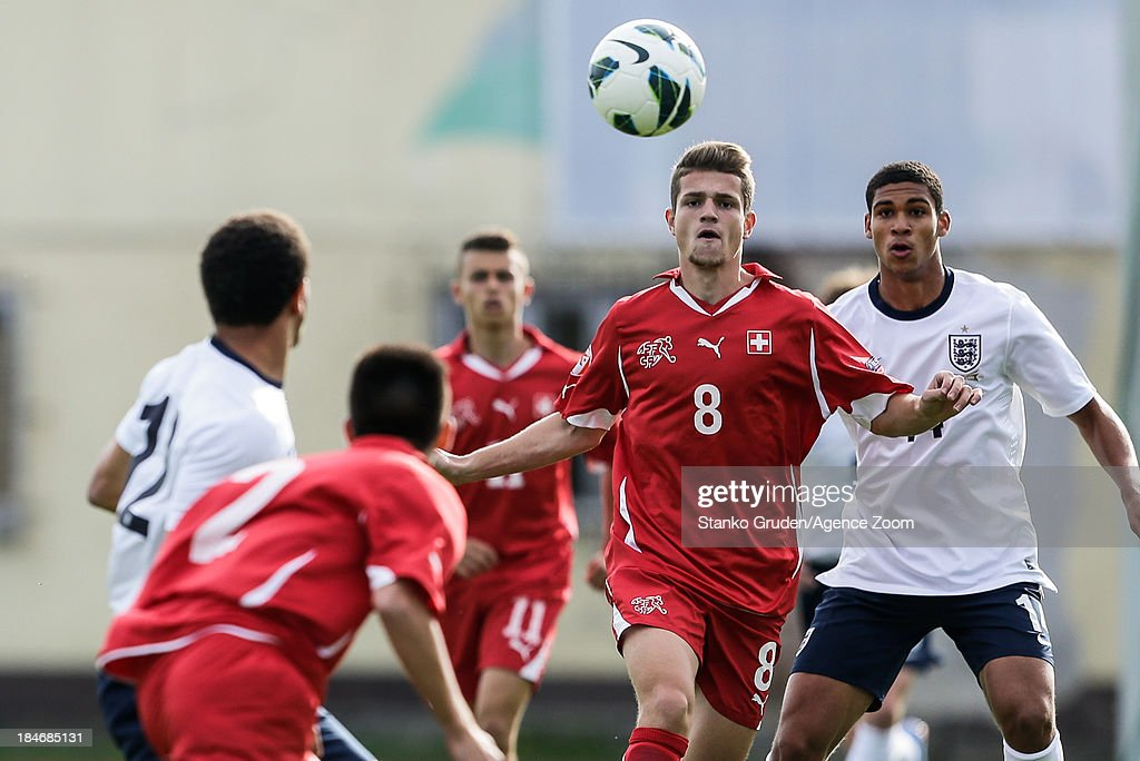 Mirsad Hasanovic of Switzerland and Carlton Morris of England during the UEFA U19 Championships Qualifier between England and Switzerland, on October 15, 2013 in Ptuj, Slovenia.