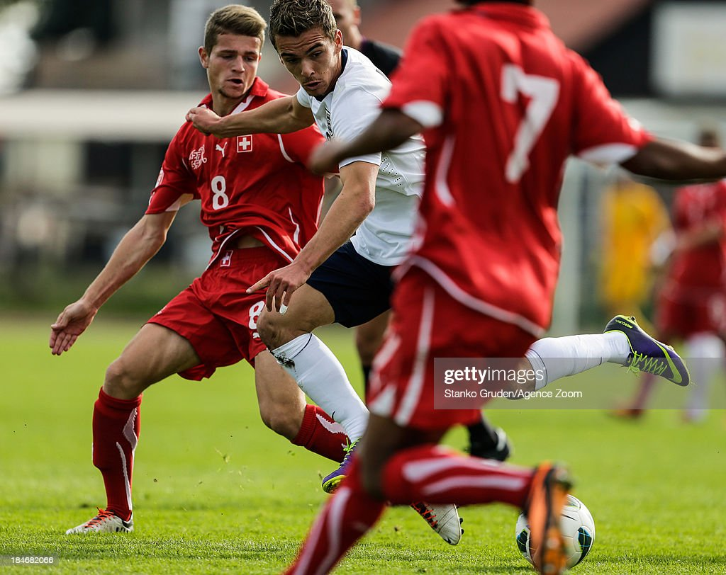 Mirsad Hasanovic of Switzerland and Ruben Loftus-Cheek of England in action during the UEFA U19 Championships Qualifier between England and Switzerland, on October 15, 2013 in Ptuj, Slovenia.