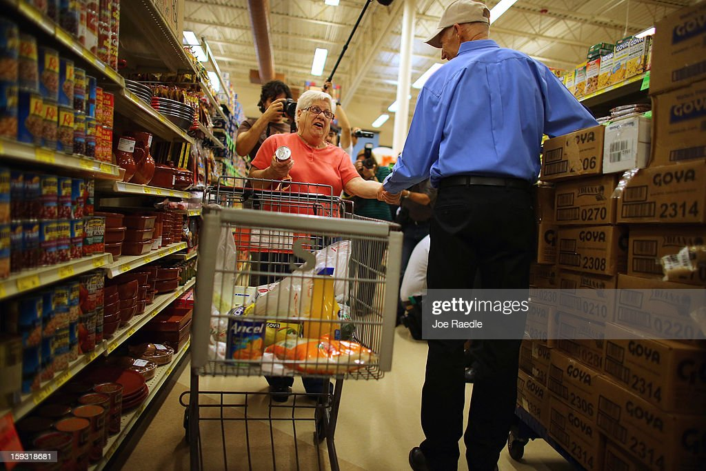 Mirta Sandomingo (L) is greeted by Florida Governor Rick Scott as he visits Sedano's Supermarket on January 11, 2013 in Miami, Florida. Governor Scott spent part of his 15th 'Let's Get to Work Day' stocking the shelves at the grocery store with Goya products as he highlights the importance of building up manufacturing jobs.