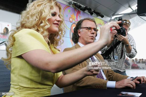 Mirusia and musician Andre Rieu sign autographs to promote Andre's latest album 'You'll never walk alone' at Blacktown Westpoint on May 8 2009 in...