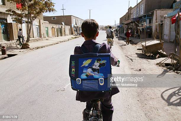 Mirwais Najrabi rides his bicycle through his neighborhood to a nearby high school October 3 2004 in Kabul Afghanistan Mirwais is the star musician...