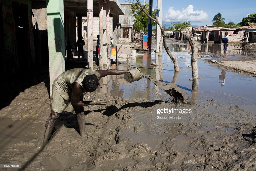 Miryam Jacques tries to bail muddy water out of family home in Gonaives Two weeks earlier the entire city had been flooded during Hurricanes Ike and...