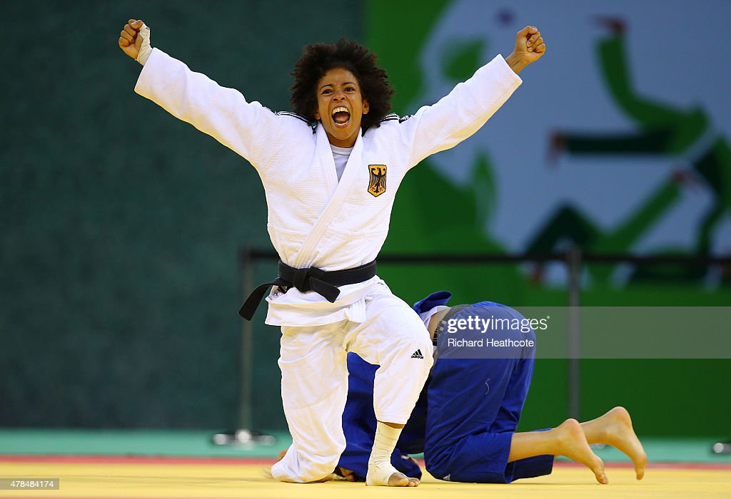 Miryam Roper of Germany (white) celebrates victory over Automne Pavia of France (blue) in the Women's Judo -57kg Bronze Final during day thirteen of the Baku 2015 European Games at the Heydar Aliyev Arena on June 25, 2015 in Baku, Azerbaijan.