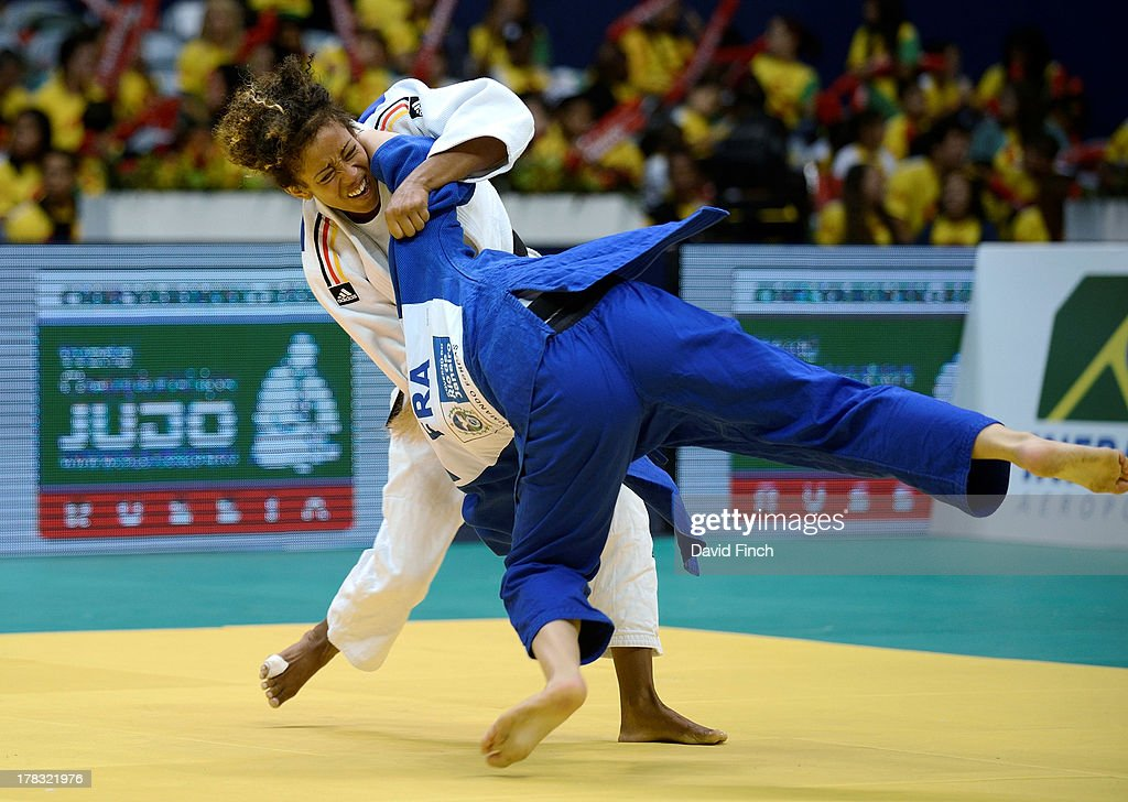 Miryam Roper of Germany (white) sweeps the legs from under Automne Pavia of France to throw her for ippon (10 points) and win the u57kgs bronze medal on day 3 of the Rio World Judo Championships, on August 28, 2013 at the Gympasium Maracanazinho, Rio de Janeiro, Brazil.