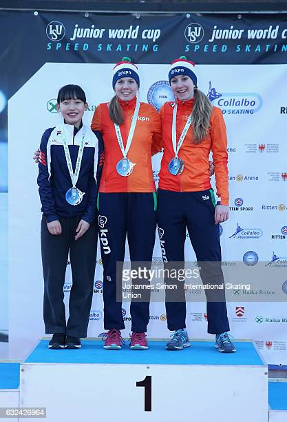 Miryeong Jeon of Korea and Elisa Dul and Sanne in 't Hof of the Netherlands pose during the medal ceremony after winning the women's junior mass...