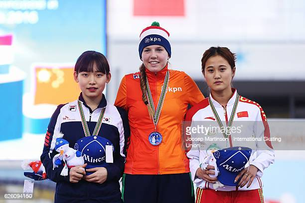 Miryeong Jeon of Korea Elisa Dul of Netherlands and Gao Yue of China pose during the Ladies Mass Start medal ceremony during day two of ISU Junior...